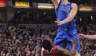 Dallas Mavericks forward Dwight Powell, right, shoots over Indiana Pacers guard Darren Collison during the first half of an NBA basketball game in Indianapolis, Saturday, Jan. 19, 2019. (AP Photo/AJ Mast)