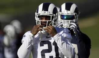 Los Angeles Rams' Aqib Talib (21) warms up during practice at the team's NFL football training facility Friday, Jan. 18, 2019, in Thousand Oaks, Calif. (AP Photo/Marcio Jose Sanchez)