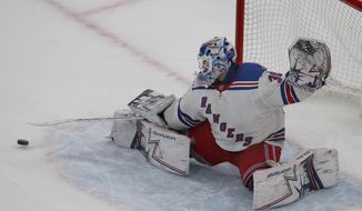 New York Rangers goaltender Henrik Lundqvist (30) makes a save during the third period of an NHL hockey game against the Boston Bruins, Saturday, Jan. 19, 2019, in Boston. (AP Photo/Mary Schwalm)