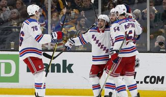 New York Rangers center Mika Zibanejad, second from right, is congratulated by teammates defenseman Brady Skjei (76), right wing Mats Zuccarello, second left, and defenseman Adam McQuaid (54) after scoring a goal during the second period of an NHL hockey game against the Boston Bruins, Saturday, Jan. 19, 2019, in Boston. (AP Photo/Mary Schwalm)