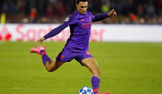 FILE - In this Tuesday, Nov. 6, 2018 file photo, Liverpool's Trent Alexander Arnold shoots the ball during their Champions League soccer match against Red Star at the Rajko Mitic stadium in Belgrade, Serbia. Liverpool and England defender Trent Alexander-Arnold has signed a new long-term contract with the Premier League leaders, it was announced Saturday, Jan. 19, 2019. The deal ties Alexander-Arnold to Liverpool until 2024, according to media reports, reflecting the progress the 20-year-old has made since his last contract in 2017. (AP Photo/Marko Drobnjakovic, file)