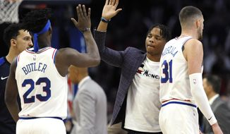 Philadelphia 76ers' Markelle Fultz, second from right, greets Jimmy Butler (23) and Mike Muscala (31) during a timeout in the second half of the team's NBA basketball game against the Oklahoma City Thunder, Saturday, Jan. 19, 2019, in Philadelphia. The Thunder won 117-115. (AP Photo/Michael Perez) ** FILE **