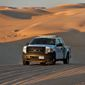 A U.S. Customs and Border Patrol agent patrols a area of sand dunes along the international border with Mexico in Imperial County, California. (Associated Press/File)  **FILE**