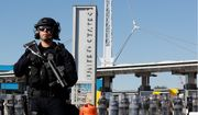 During a training drill, Customs and Border Protection officials block the entrance to the San Ysidro port of entry. (Associated Press/File)