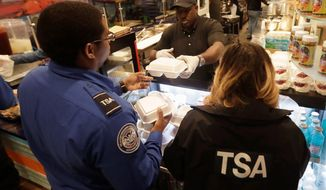 Chef Creole owner Wilkinson Sejour hands out free hot meals to TSA workers at his restaurant at Miami International Airport, on Jan. 15, 2019. (Associated Press)