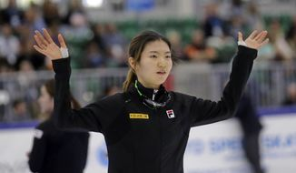 First place finisher Shim Suk-hee, from South Korea, celebrates following the women's 1,500-meter finals at a World Cup short track speedskating event at the Utah Olympic Oval on Sunday, Nov. 13, 2016, in Kearns, Utah. (AP Photo/Rick Bowmer)