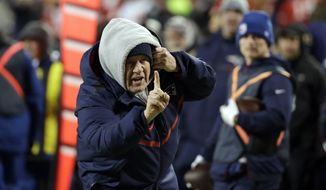 New England Patriots head coach Bill Belichick during the overtime of the AFC Championship NFL football game, Sunday, Jan. 20, 2019, in Kansas City, Mo. (AP Photo/Elise Amendola)