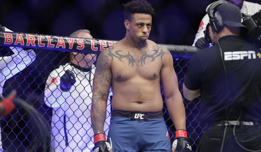 Greg Hardy waits for his heavyweight mixed martial arts bout against Allen Crowder at UFC Fight Night on Saturday, Jan. 19, 2019, in New York. Crowder won after Hardy was disqualified for an illegal knee. (AP Photo/Frank Franklin II) ** FILE **