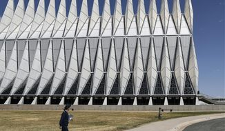 In this April 12, 2017, photo, the Cadet Chapel towers over the U.S. Air Force Academy campus outside Colorado Springs, Colo. The landmark Cadet Chapel is suffering from leaks and corrosion, so the school has drawn up the most ambitious restoration project in the building's 55-year history. (AP Photo/Thomas Peipert)