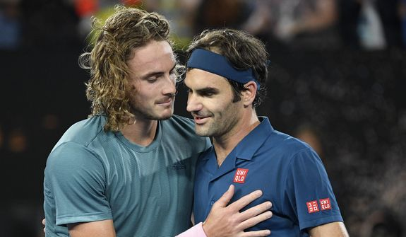 Greece's Stefanos Tsitsipas, left, is congratulated by Switzerland's Roger Federer after winning their fourth round match at the Australian Open tennis championships in Melbourne, Australia, Sunday, Jan. 20, 2019. (AP Photo/Andy Brownbill) **FILE**