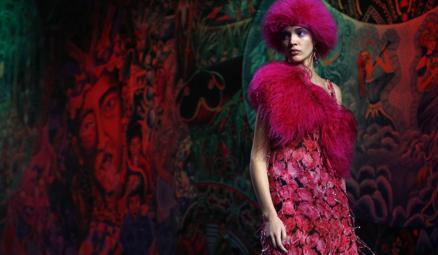 A model wears a creation during Kenzo men's and women's Fall/Winter 2019/20 fashion collection presented in Paris, Sunday Jan .20, 2019. (AP Photo/Christophe Ena)