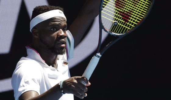 United States' Frances Tiafoe gestures for a video review of a line call during his fourth round match against Bulgaria's Grigor Dimitrov at the Australian Open tennis championships in Melbourne, Australia, Sunday, Jan. 20, 2019. (AP Photo/Kin Cheung)