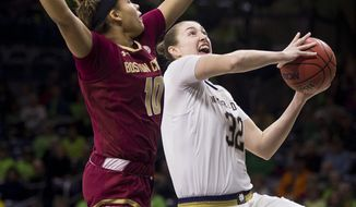 Notre Dame's Jessica Shepard (32) drives in for a layup in front of Boston College's Makayla Dickens (10) during the first half of an NCAA college basketball game Sunday, Jan. 20, 2019, in South Bend, Ind. (AP Photo/Robert Franklin)