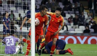 China's forward Xiao Zhi celebrates after scoring his side's opening goal during the AFC Asian Cup round of 16 soccer match between Thailand and China at the Hazza Bin Zayed stadium in Al Ain, United Arab Emirates, Sunday, Jan. 20, 2019. (AP Photo/Hassan Ammar)