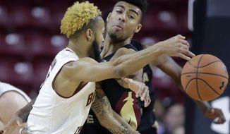 Boston College's Ky Bowman, left, tries to pass around Florida State's Anthony Polite, right, in the first half of an NCAA college basketball game, Sunday, Jan. 20, 2019, in Boston. (AP Photo/Steven Senne)