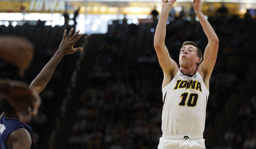 Iowa guard Joe Wieskamp (10) shoots a three-point basket against Illinois during the second half of an NCAA college basketball game, Sunday, Jan. 20, 2019, in Iowa City. (AP Photo/Matthew Putney)