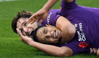 Fiorentina's forward Luis Muriel, right, celebrates with a teammate after scoring during a Serie A soccer match between Fiorentina and Sampdoria at the Artemio Franchi stadium in Florence, Italy, Sunday, Jan. 20, 2019. (Claudio Giovannini/ANSA via AP)