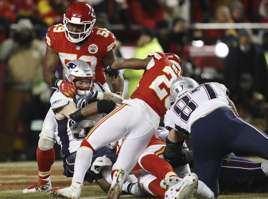 New England Patriots running back Rex Burkhead (34) dives to the end zone for a touchdown during the overtime of the AFC Championship NFL football game against the Kansas City Chiefs, Sunday, Jan. 20, 2019, in Kansas City, Mo. (AP Photo/Jeff Roberson)