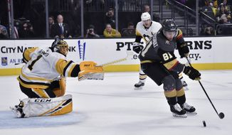 Vegas Golden Knights center Jonathan Marchessault (81) skates with the puck in front of Pittsburgh Penguins goaltender Casey DeSmith during the second period of an NHL hockey game Saturday, Jan. 19, 2019, in Las Vegas. (AP Photo/David Becker)