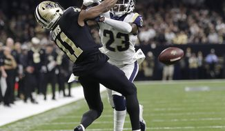 Los Angeles Rams' Nickell Robey-Coleman breaks up a pass intended for New Orleans Saints' Tommylee Lewis during the second half of the NFL football NFC championship game, Sunday, Jan. 20, 2019, in New Orleans. (AP Photo/Gerald Herbert)