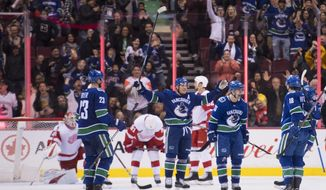 Vancouver Canucks left wing Antoine Roussel (26) celebrates his goal against the Detroit Red Wings during third-period NHL hockey game action in Vancouver, British Columbia, Sunday, Jan 20, 2019. (Jonathan Hayward/The Canadian Press via AP)