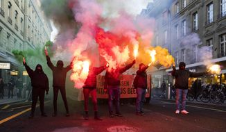 Protesters burn fireworks during a demonstration against the World Economic Forum (WEF) in Bern, Switzerland, Saturday, Jan. 19, 2019. The WEF will take place from January 22 till January 25 in Davos. (Peter Klaunzer/Keystone via AP)