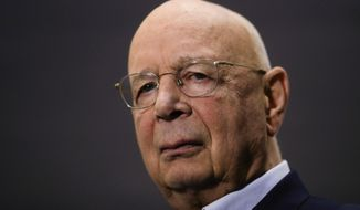 Klaus Schwab, founder and Executive Chairman of the World Economic Forum, poses during an interview by the Associated Press on the eve of the World Economic Forum, WEF, in Davos, Switzerland, Sunday, Jan. 20, 2019. (AP Photo/Markus Schreiber)