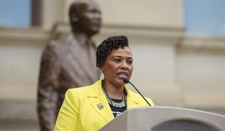 "FILE - In this Apr. 9, 2018, file photo, Bernice King addresses the crowd at the Capital during the March for Humanity marking the 50th anniversary of the Rev. Martin Luther King Jr.'s assassination which commenced at Ebenezer Baptist Church and concluded at the state capital in Atlanta. King blasted Steve Bannon's claim that her father would be proud of President Donald Trump. ""#SteveBannon has dangerously and erroneously co-opted my father's name, work and words,"" King wrote just before midnight Wednesday, May 23, in the first of a series of tweets. ""Bannon's assertion that my father, #MLK, would be proud of Donald Trump wholly ignores Daddy's commitment to people of all races, nationalities, etc. being treated with dignity and respect."" (AP Photo/Todd Kirkland, File)"