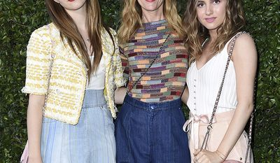 Iris Apatow, from left, Leslie Mann and Maude Apatow attend Chanel and NRDC Host Dinner to Celebrate Our Majestic Oceans on Saturday, June 2, 2018, in Malibu, Calif. (Photo by Richard Shotwell/Invision/AP)
