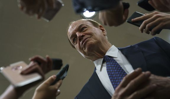 """The bill, introduced by Appropriations Committee Chairman Richard Shelby, runs to 1,301 pages. """"The president has proposed a serious compromise to end this shutdown,"""" Mr. Shelby said. """"It would not only fund the government and secure the border, but also provide immigration reforms the Democrats have long supported."""" (Associated Press)"""