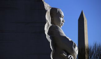The Martin Luther King, Jr. Memorial on MLK Day, Monday, Jan. 21, 2019, in Washington, with the Washington monument, rear.  (AP Photo/Jacquelyn Martin)