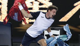 Spain's Pablo Carreno Busta throws his bag in frustration after losing his fourth round match to Japan's Kei Nishikori at the Australian Open tennis championships in Melbourne, Australia, Monday, Jan. 21, 2019. (AP Photo/Aaron Favila)