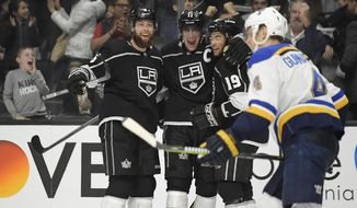 Los Angeles Kings center Anze Kopitar, second from left, celebrates his goal with defenseman Jake Muzzin, left, and left wing Alex Iafallo, second from right, as St. Louis Blues defenseman Carl Gunnarsson skates by during the second period of an NHL hockey game Monday, Jan. 21, 2019, in Los Angeles. (AP Photo/Mark J. Terrill)