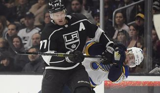 Los Angeles Kings center Jeff Carter, left, hits St. Louis Blues defenseman Alex Pietrangelo during the second period of an NHL hockey game Monday, Jan. 21, 2019, in Los Angeles. (AP Photo/Mark J. Terrill)