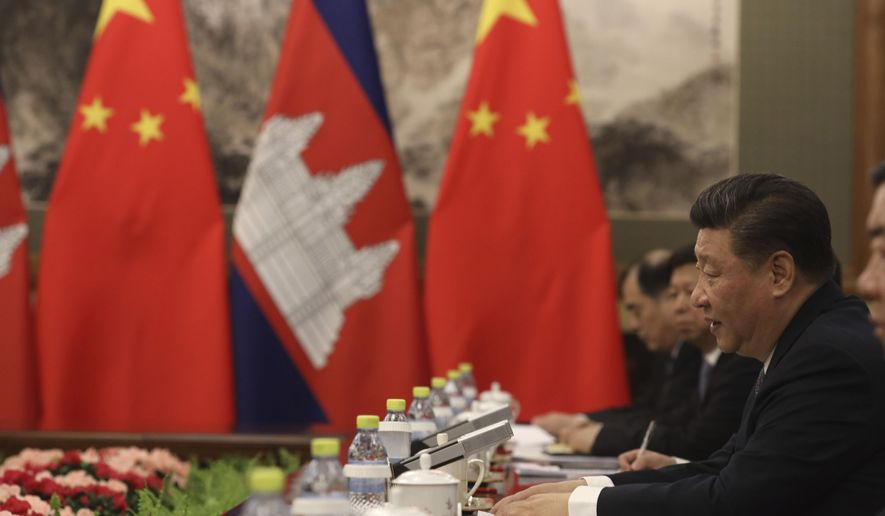 Chinese President Xi Jinping, right, speaks during a meeting with Cambodian Prime Minister Hun Sen, unseen, at the Diaoyutai state guesthouse in Beijing, China, Monday, Jan. 21, 2019. (AP Photo/Ng Han Guan, Pool)