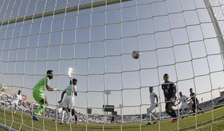 Japan's defender Takehiro Tomiyasu scores the opening goal during the AFC Asian Cup round of 16 soccer match between Japan and Saudi Arabia at the Sharjah Stadium in Sharjah, United Arab Emirates, Monday, Jan. 21, 2019. (AP Photo/Hassan Ammar)
