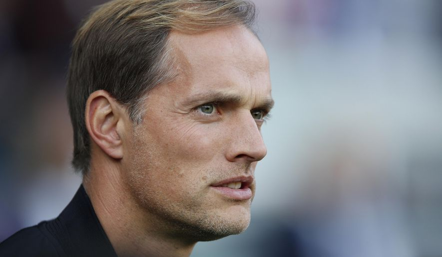 FILE - In this Oct. 20, 2018, file photo, PSG's coach Thomas Tuchel watches ahead of a French League One soccer match between Paris-Saint-Germain and Amiens at the Parc des Princes stadium in Paris. Tuchel needs Adrien Rabiot back in the side because an injury to Marco Verratti left Paris Saint-Germain seriously short of options in midfield. Verratti's injury is a major headache for Tuchel, who even before the injury made it very clear that he desperately needs another central midfielder to bolster his squad. (AP Photo/Francois Mori, File)