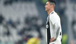 Juventus' Cristiano Ronaldo reacts during the match against AC Chievo Verona, during their Italian Serie A soccer match Juventus FC vs AC Chievo Verona at Allianz stadium in Turin, Italy, Monday Jan. 21, 2019. (Alessandro Di Marco/ANSA via AP)