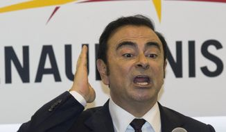 In this April 25, 2016, file photo, then Renault-Nissan's CEO Carlos Ghosn speaks during a press conference held at Auto China 2016 in Beijing, China. (AP Photo/Ng Han Guan, File)