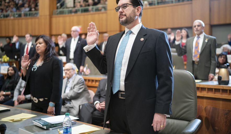 New Mexico Speaker of the House Brian Egolf is sworn in as a representative during the opening of the New Mexico legislative session at the state Capitol in Santa Fe, N.M. on Tuesday, Jan. 15, 2019. (AP Photo/Craig Fritz)