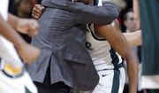 Michigan State coach Tom Izzo, left, hugs Cassius Winston during a timeout the second half of an NCAA college basketball game against Maryland, Monday, Jan. 21, 2019, in East Lansing, Mich. Michigan State won 69-55. (AP Photo/Al Goldis)