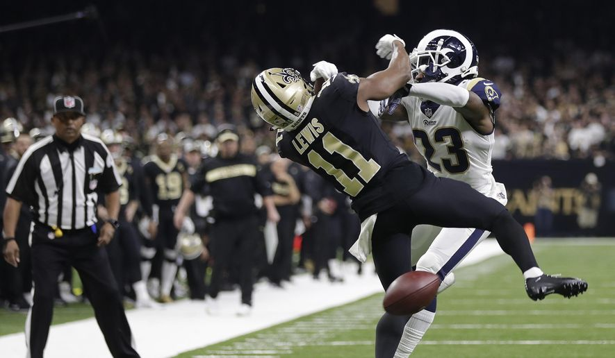 New Orleans Saints wide receiver Tommylee Lewis (11) works for a catch against Los Angeles Rams defensive back Nickell Robey-Coleman (23) during the second half the NFL football NFC championship game Sunday, Jan. 20, 2019, in New Orleans. The Rams won 26-23. (AP Photo/Gerald Herbert) **FILE**
