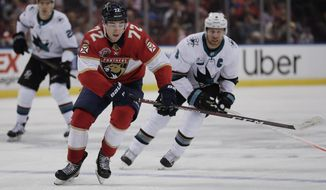 Florida Panthers center Frank Vatrano rushes to gain control of the puck against San Jose Sharks center Joe Pavelski during the second period of an NHL hockey game, Monday, Jan. 21, 2019, in Sunrise, Fla. (AP Photo/Brynn Anderson)