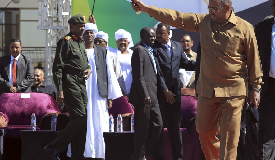 FILE - In this Wednesday, Jan. 9, 2019 file photo, Sudanese President Omar al-Bashir greets his supporters at a rally in Khartoum, Sudan. The anti-government protests rocking Sudan for the past month are reminiscent of the Arab Spring uprisings of nearly a decade ago. Demonstrators, many in their 20s and 30s, are trying to remove President Omar al-Bashir, an authoritarian leader, and win freedoms and human rights. (AP Photo/Mahmoud Hjaj, file)