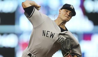 FILE - In this Sept. 11, 2018, file photo, New York Yankees pitcher Sonny Gray throws against the Minnesota Twins in the first inning of a baseball game in Minneapolis. A person familiar with the negotiations tells The Associated Press that Gray has agreed to a contract with Cincinnati adding $30.5 million from 2020-22, a deal that allows the Yankees to complete his trade to the Reds. The person spoke on condition of anonymity Monday, Jan. 21, 2019, because the trade had not been announced. (AP Photo/Jim Mone, File)