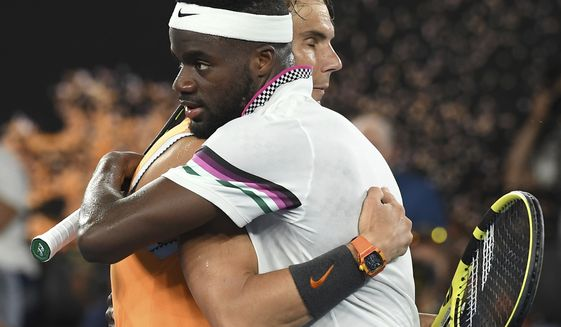 Spain's Rafael Nadal, left, is congratulated by United States' Frances Tiafoe after defeating him in their quarterfinal match at the Australian Open tennis championships in Melbourne, Australia, Tuesday, Jan. 22, 2019.(AP Photo/Andy Brownbill)