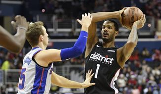 Washington Wizards forward Trevor Ariza (1) holds the ball against Detroit Pistons guard Luke Kennard (5) during the second half of an NBA basketball game, Monday, Jan. 21, 2019, in Washington. The Wizards won 101-87. (AP Photo/Nick Wass) **FILE**