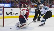 San Jose Sharks center Logan Couture (39) scores past Washington Capitals goaltender Braden Holtby (70) in the second period of an NHL hockey game, Tuesday, Jan. 22, 2019, in Washington. (AP Photo/Alex Brandon)