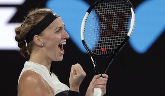 Petra Kvitova of the Czech Republic celebrates after defeating Australia's Ashleigh Barty in their quarterfinal match at the Australian Open tennis championships in Melbourne, Australia, Tuesday, Jan. 22, 2019. (AP Photo/Aaron Favila)