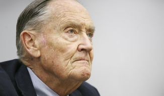 FILE- In this May 20, 2008, file photo John Bogle listens during an interview at The Associated Press in New York. The surge in popularity for index funds is a product of their lower fees, better performance and the preaching of Bogle, the founder of Vanguard Group, which launched the first index mutual fund for individual investors in 1976. Bogle died Wednesday, Jan. 16, 2019, at 89 after pushing for years to keep costs down and widen access to index funds. (AP Photo/Mark Lennihan, File)